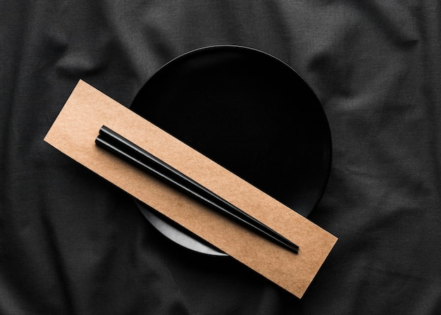 Top view of chopsticks on plate