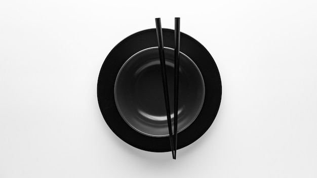 Top view of  chopsticks with dinnerware
