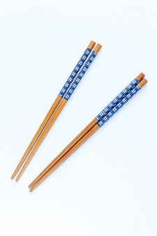 Top view chopsticks for wooden with clipping path on white background. home decor kitchen accessories used as a component of tableware photos and webpage icon.