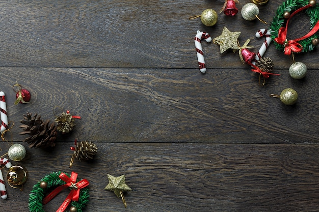 Top view chrismas decorations and christmas ornaments on wooden background with copy space.