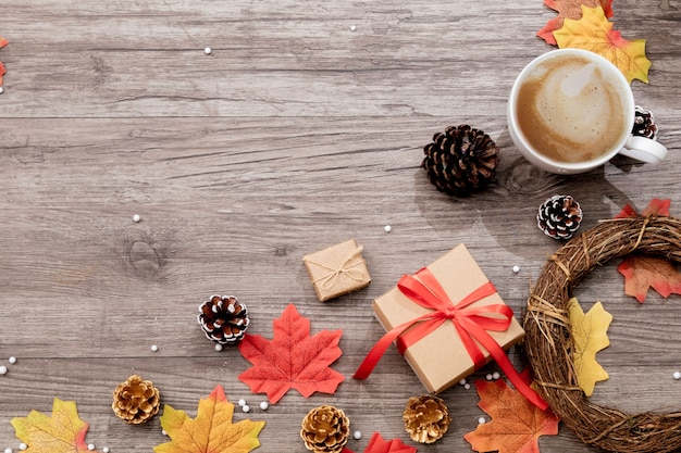 Top view of christmas and autumn decorations on wooden desk
