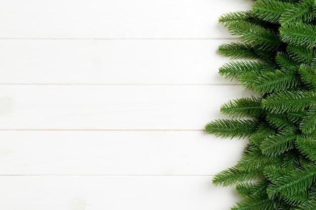 Top view of christmas background made of fir tree branches. new year concept with copy space on wooden background