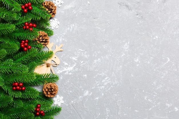 Top view of christmas background made of fir tree and decorations on cement background. new year holiday concept with copy space