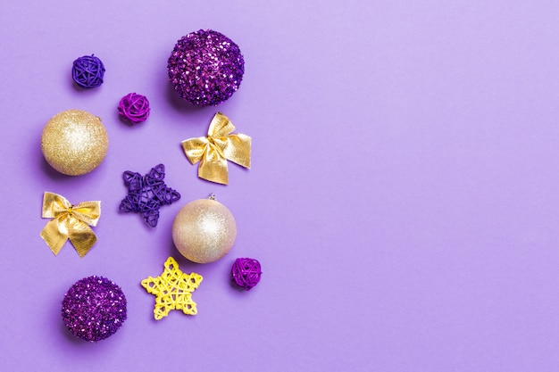 Top view of christmas balls and creative decorations on colorful background with copy space.