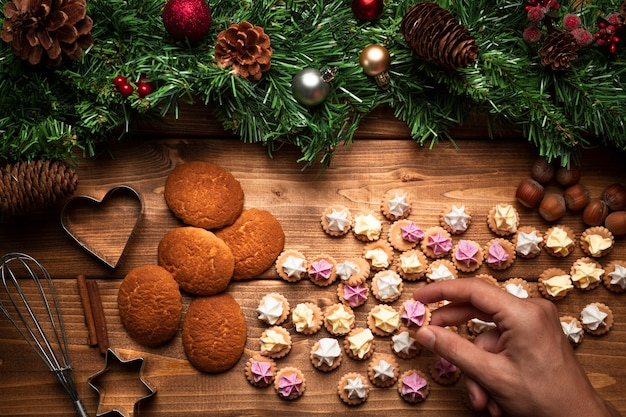 Top view christmas biscuits with wooden background