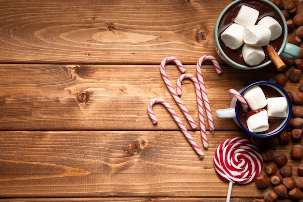 Top view christmas candy with wooden background