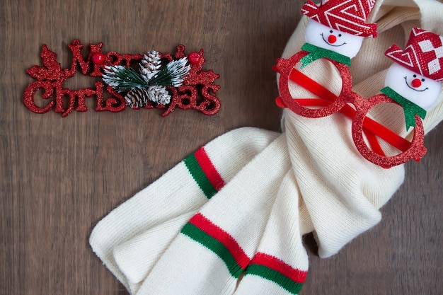 Top view of christmas concept on wooden background