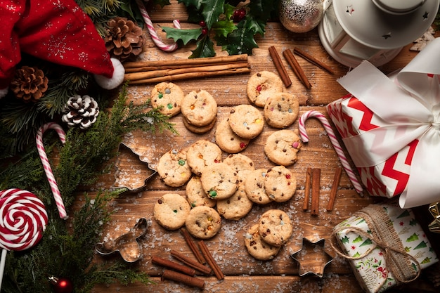 Top view christmas cookies with wooden background