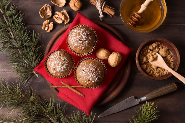 Top view of christmas cupcakes with walnuts and honey