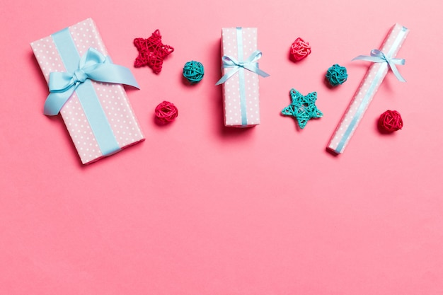 Top view of christmas decations on pink background. new year holiday concept with copy space