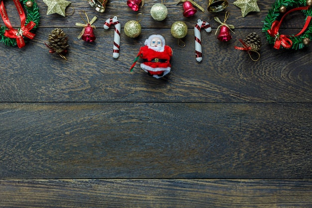 Top view christmas decoration and santa claus doll on wooden background with copy space.