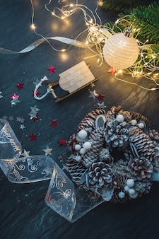 Top view of christmas decorations and lights on the wooden table