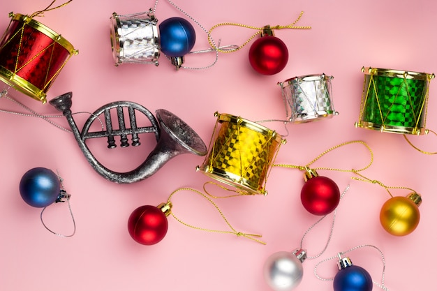 Top view christmas decorations on a pastel pink background