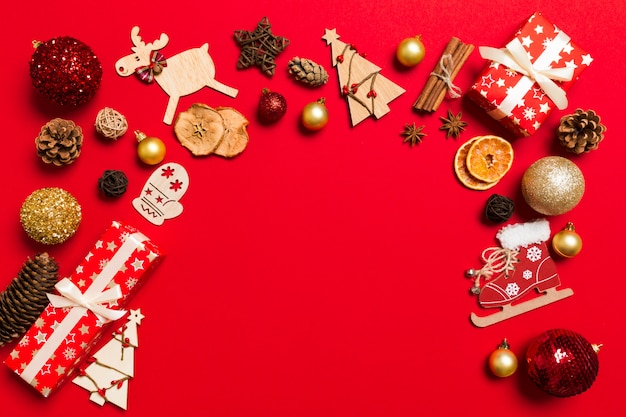Top view christmas decorations on red .   holiday   copyspace