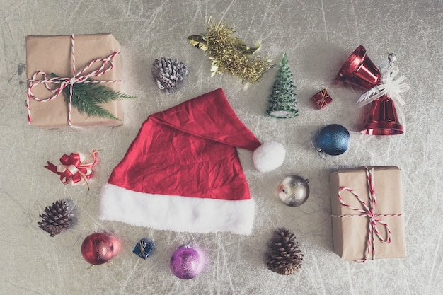 Top view of christmas decorations on silver background.