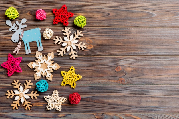 Top view of christmas decorations and toys on wooden background. copy space. empty place for your design.