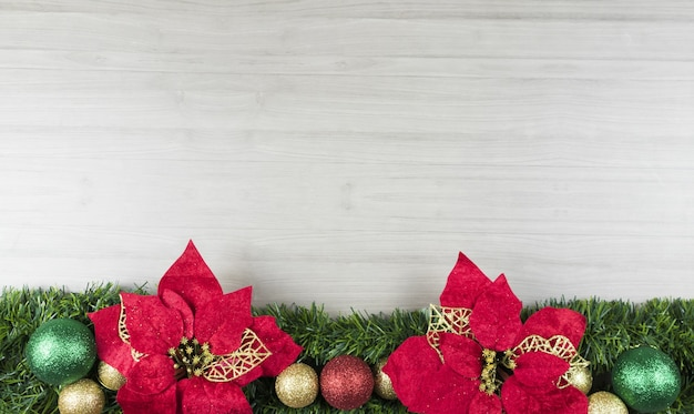 Top view of christmas decorations on wooden board