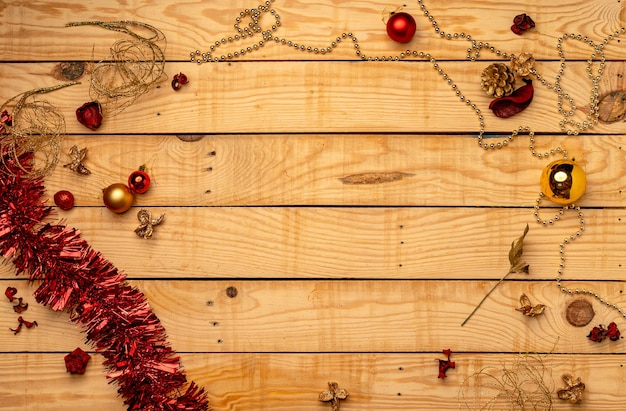 Top view of christmas decorations on a wooden texture
