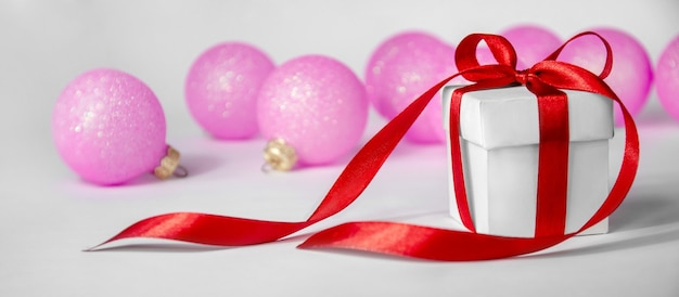 Top view christmas decorative globes and gift box