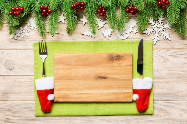 Top view of christmas dinner on wooden background