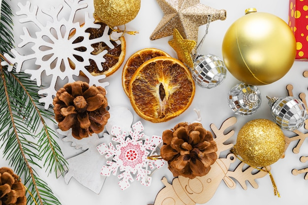 Top view christmas flat lay on white background. new year 2021. golden and green colors. high quality photo
