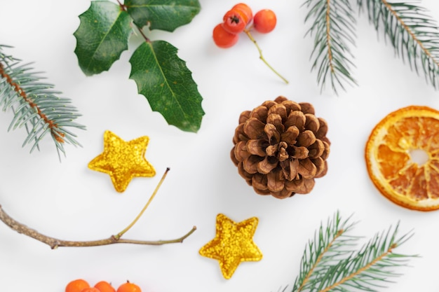 Top view christmas flat lay on white background. new year 2021. golden and green colors
