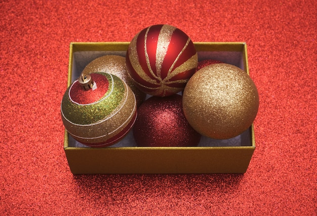 Top view of christmas gift box with christmas balls inside with copy space.