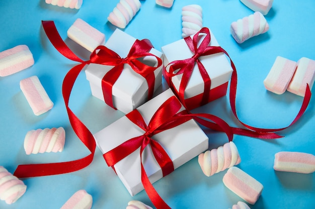 Top view christmas gift boxes and marshmallow