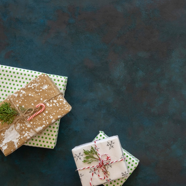 Top view of christmas gifts with candy cane and copy space