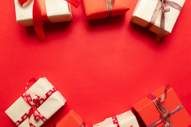 Top view on christmas gifts wrapped in gift paper decorated with ribbon on . new year, holidays and celebration