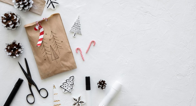 Top view of christmas paper bag with scissors and copy space