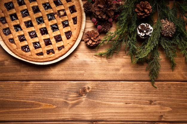 Top view christmas pie with wooden background