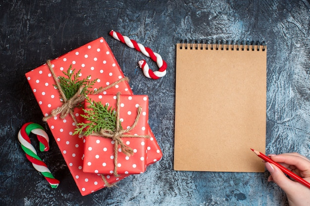 Top view christmas presents with notebook