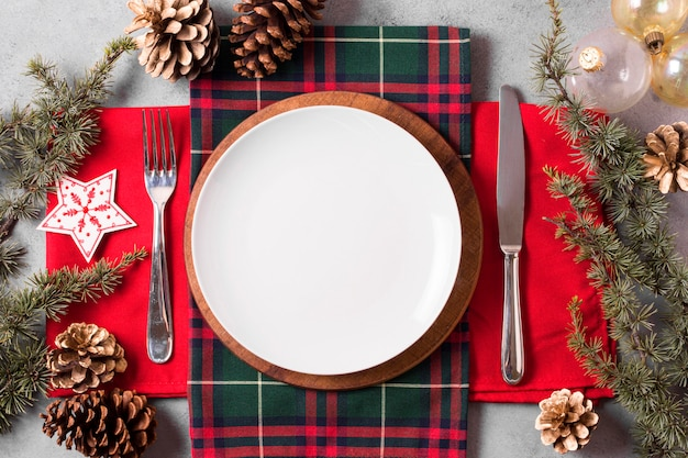 Top view of christmas table arrangement with plate and cutlery