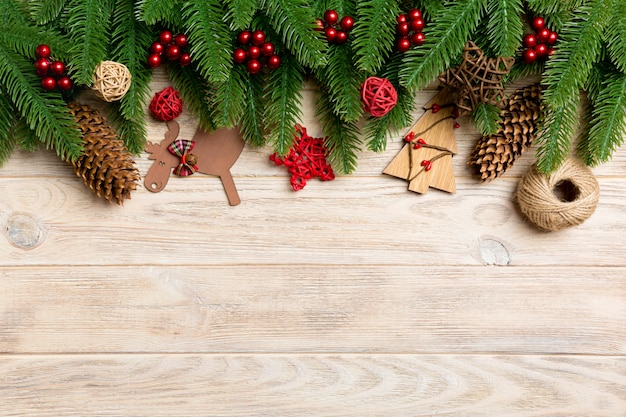 Top view christmas toys, decorations and fir tree branches on wooden .   holiday   copyspace