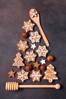 Top view of christmas tree shape made of gingerbread cookies and kitchen utensils