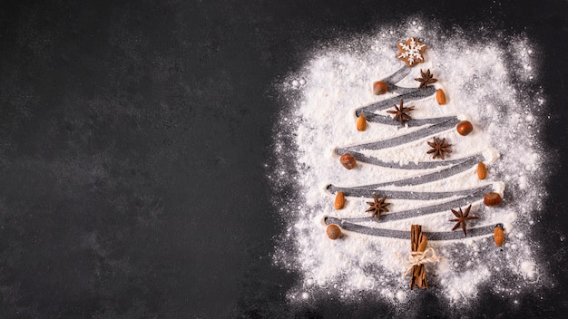 Top view of christmas tree shape with flour and and copy space