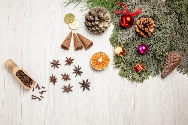 Top view christmas tree with cones and toys on white space