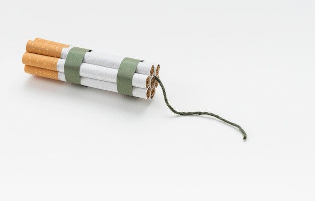 Top view of cigarette bundle and wick against white background