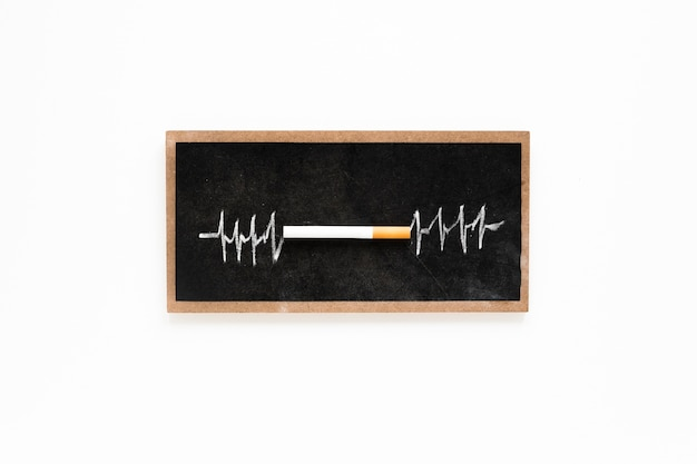 Top view cigarette on a chalkboard