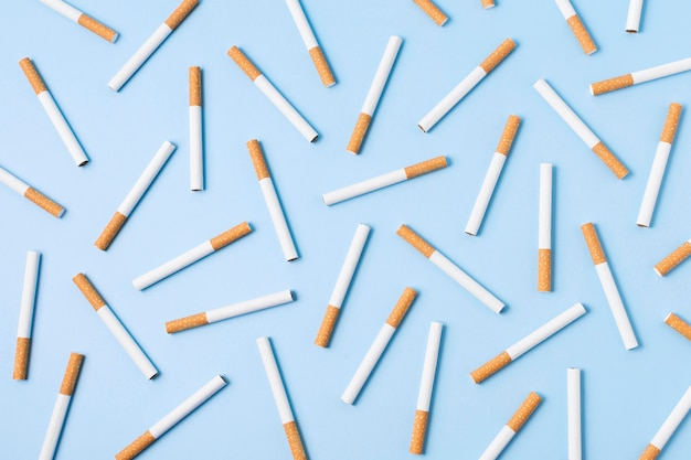 Top view cigarettes on blue background