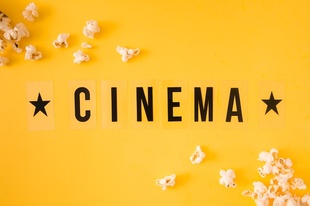 Top view cinema lettering on yellow background
