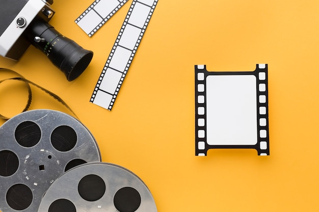 Top view cinema objects on yellow background