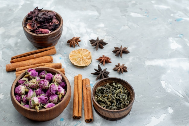 A top view cinnamon and flowers along with dried lemon slice dry fruit flower plant