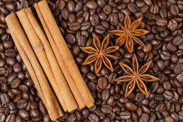 Top view of cinnamon sticks with coffee beans
