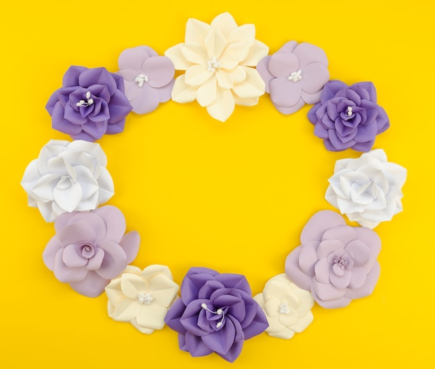 Top view circular floral frame withyellow background