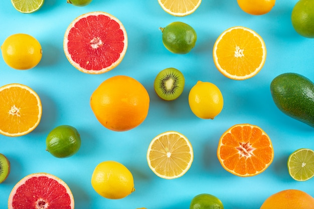 Top view citrus fruits pattern on blue surface