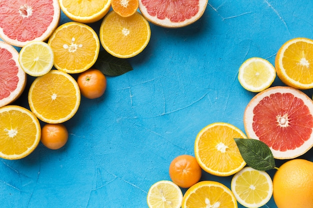 Top view of citrus fruits with copy space
