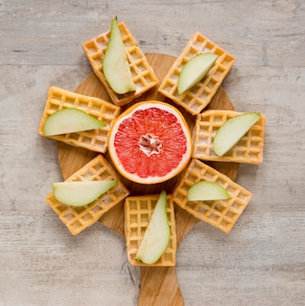 Top view of citrus with waffles and pears