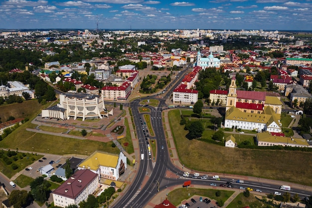 Top view of the city center of grodno, belarus. the historic center of the city with a red tile roof and an old catholic church.